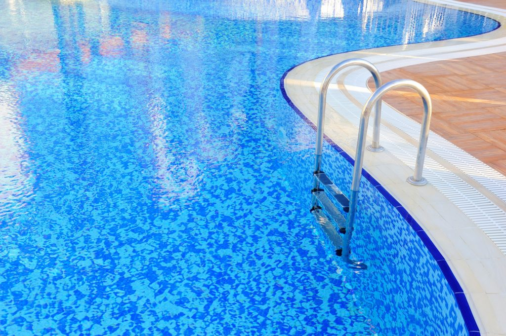 Swimming pool with stair at hotel close-up
